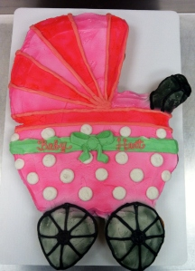 A baby carriage made from 45 cupcakes