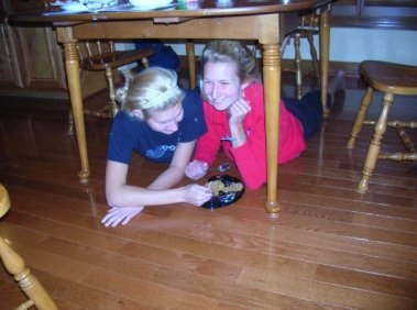 All sisters eat dessert under the kitchen table right?